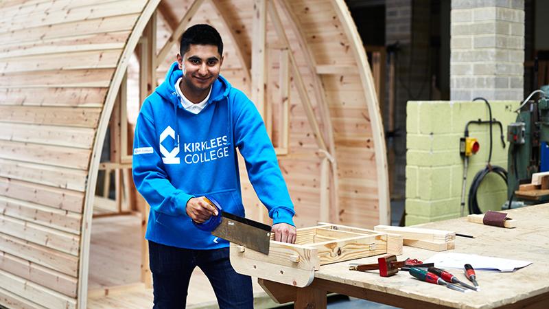 Student using construction equipment