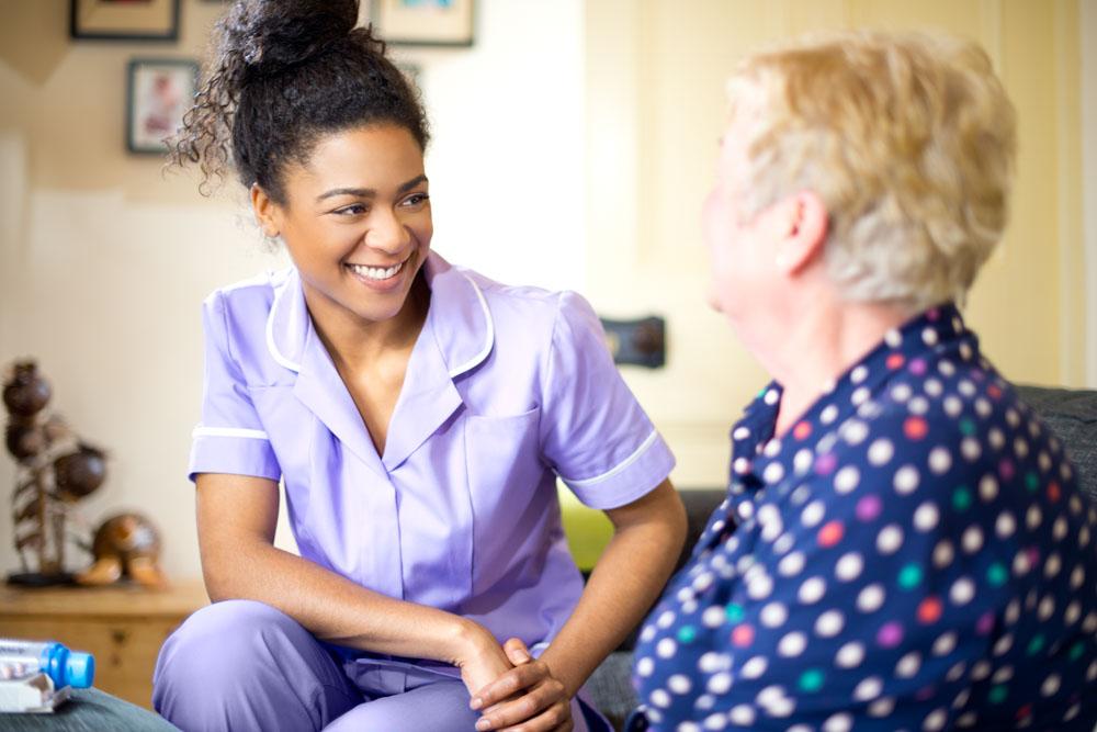 Nurse talking to a woman